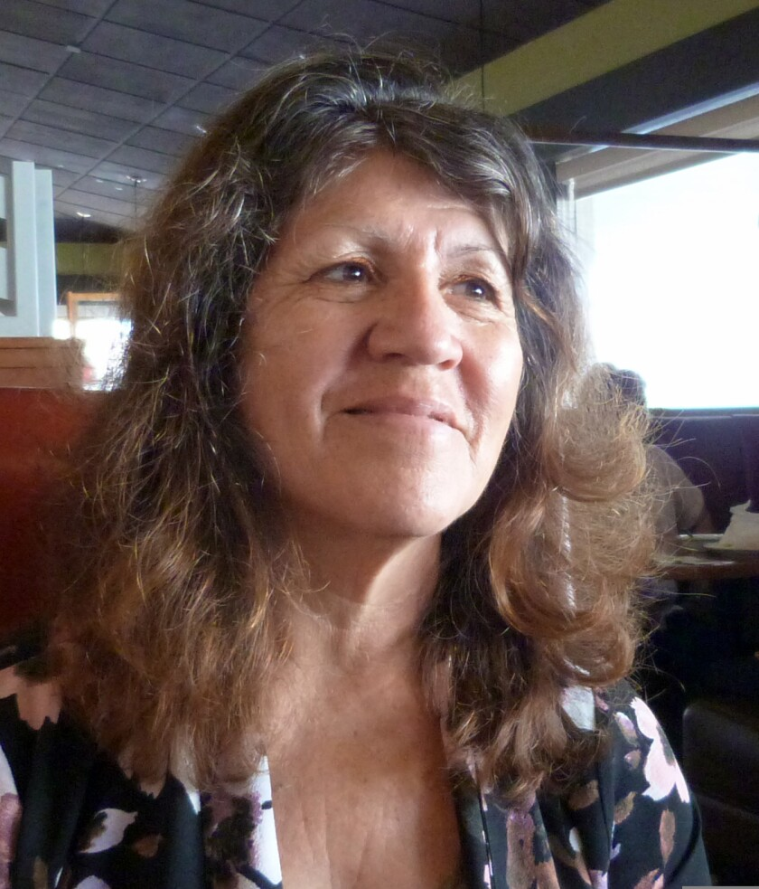 Community activist Elena Saldivar wants state officials to prove that dairy digesters are improving local air quality.
