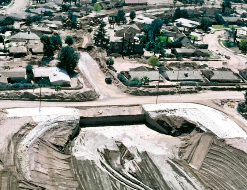 An aerial image of a debris-flow basin built at the bottom of a hillside in San Bernardino, California.