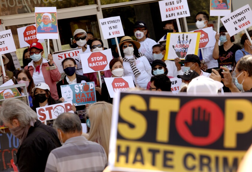 Members of the Thai-American community participate in a rally against Asian hate crimes in Los Angeles