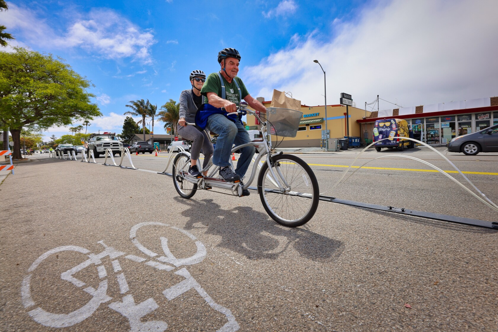 A couple takes advantage of the newly protected bike lane on Portola Drive on Tuesday.