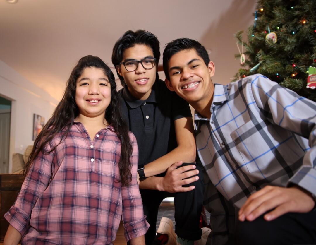 Maribel, 9, Domingo, 18, and Frankie, 16.