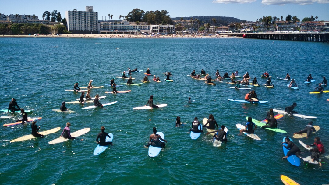 Surfers form a circle during a pre-Juneteenth paddle-out Sunday.