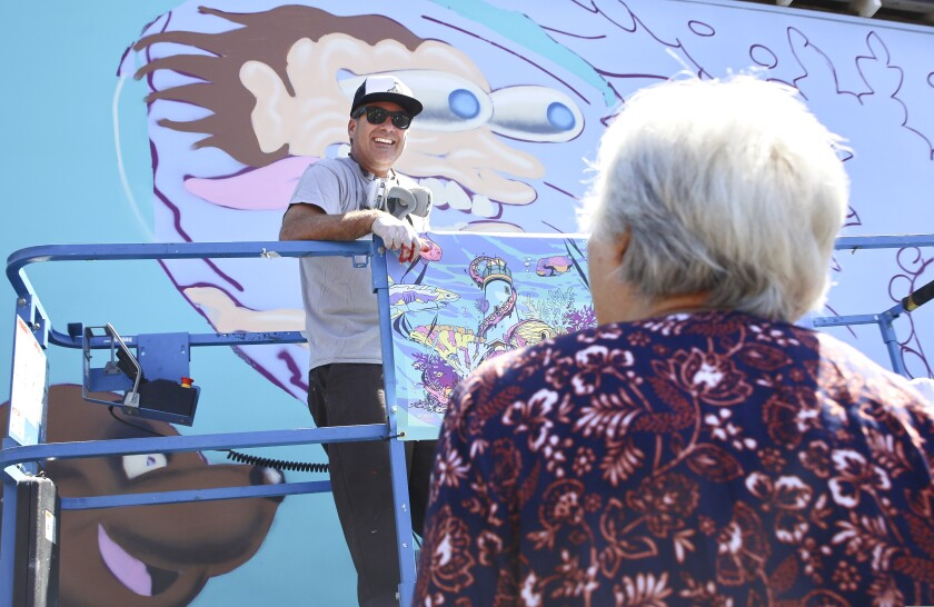 Artist Jimbo Phillips at work on his mural at 142 River St.
