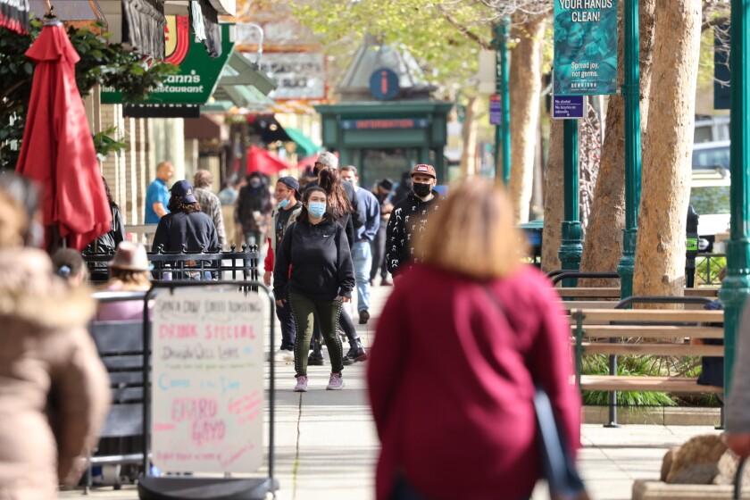 Shoppers line sidewalks in Downtown Santa Cruz on March 25.