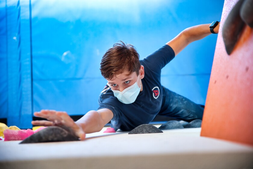 Daniel Hutton, 13, reaches for a hold during a session at Agility Boulders in Capitola.