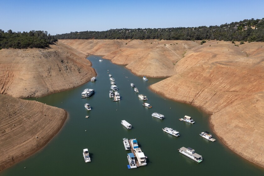 Boats are moored in a shrinking arm of Lake Oroville, which stands at 33% full and 40% of historical average.