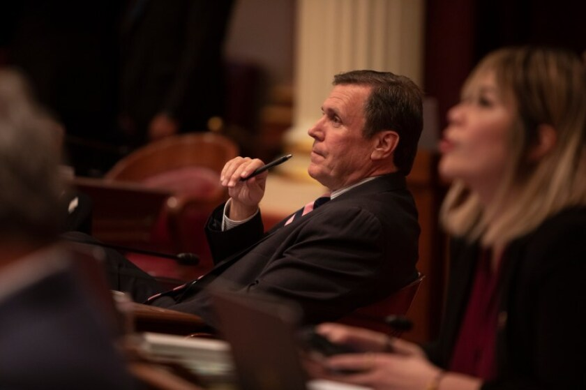 Sen. Scott Wilk listens to comments by his colleagues on the Senate floor