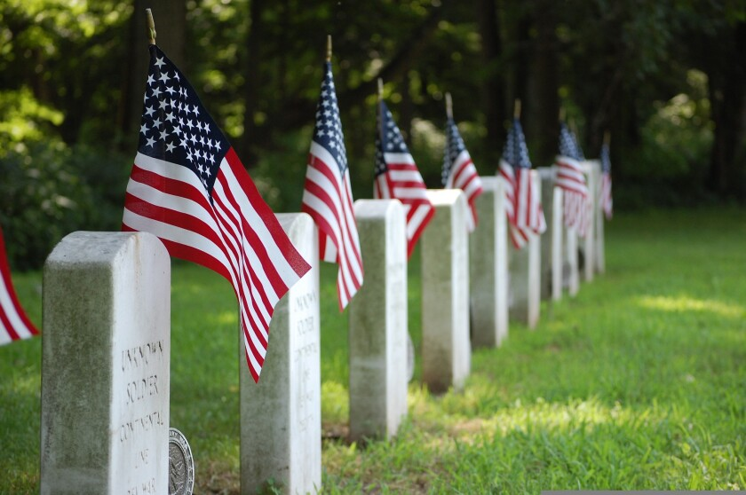 File image of American flags placed next to graves in a cemetery