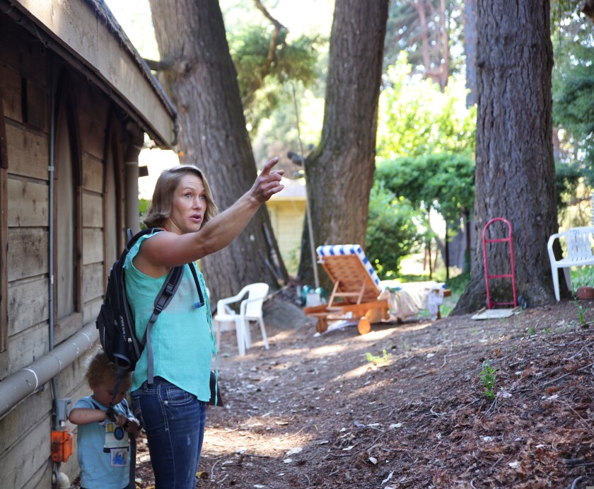 Lexi Seath surveys the area where she dug in.