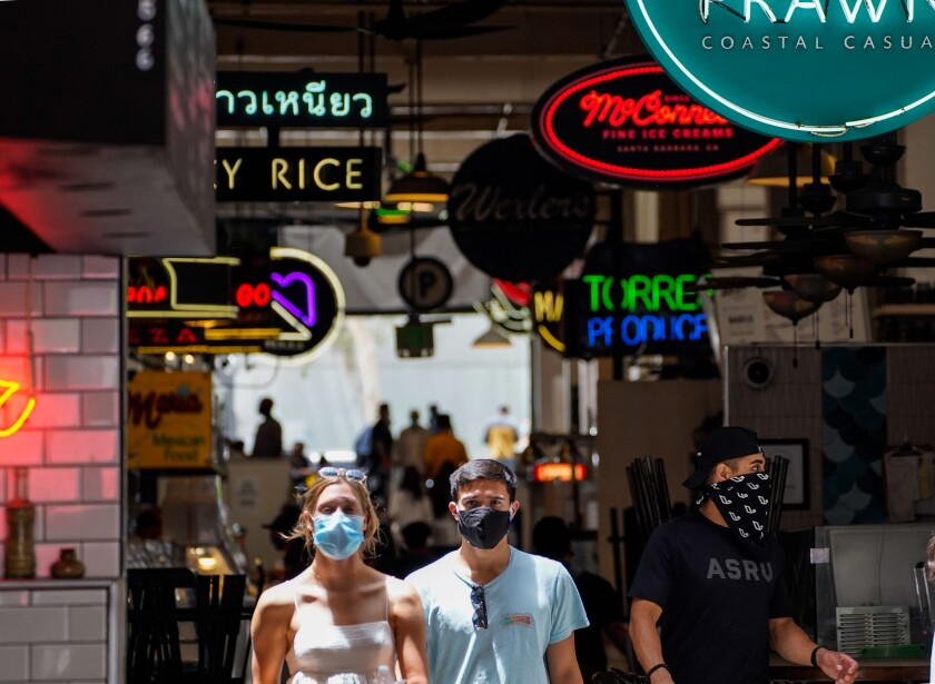 LOS ANGELES, CA - JUNE 25: People in downtown Los Angeles on Thursday, June 25, 2020 in Los Angeles, CA. Los Angeles County Is supposed to reach 90,000 active covid cases today and the state may reach 200,000 cases, with Mayor Eric Garcetti ca;;omg for Angelenos to stay indoors amid the surge in COVID-19 cases.