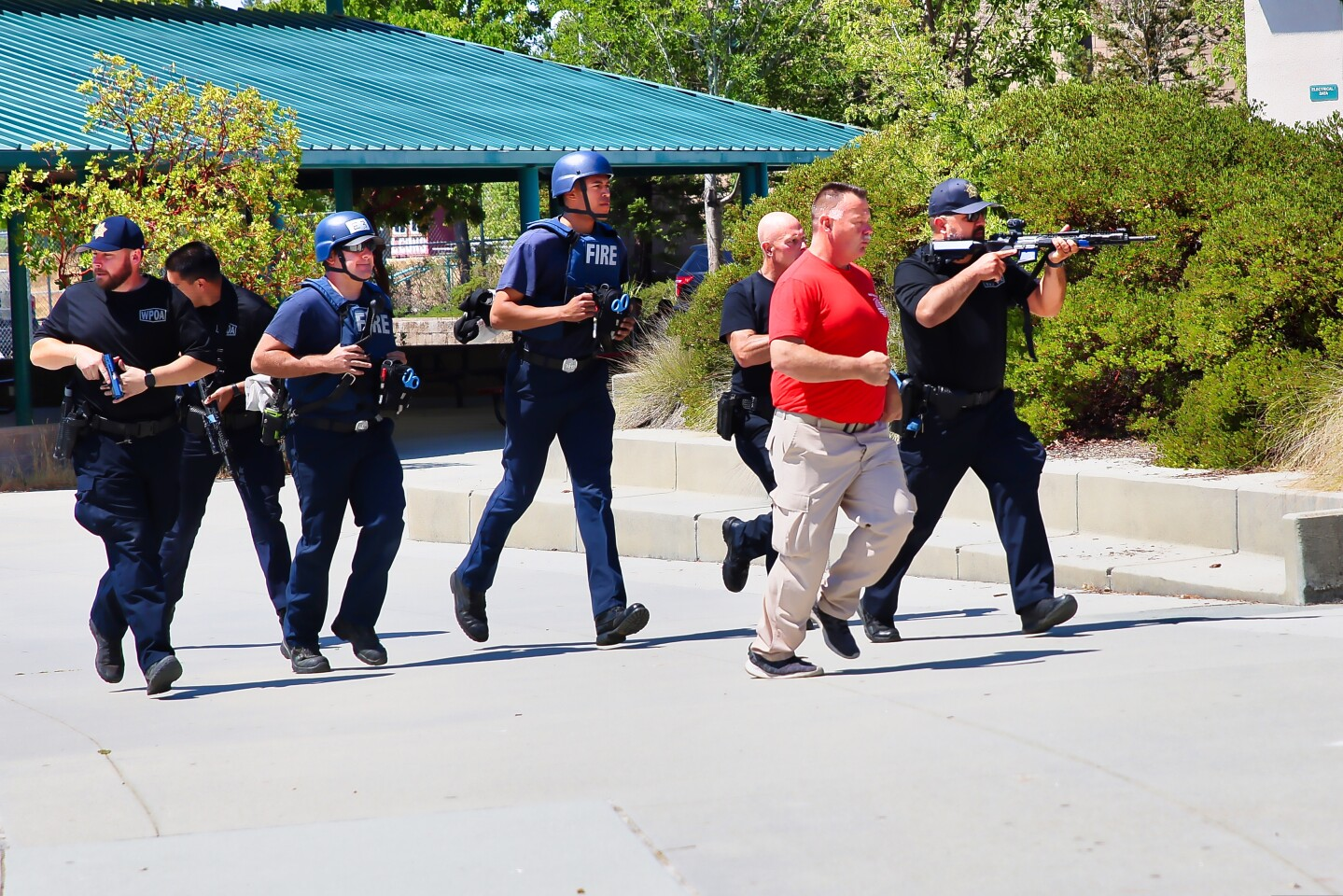 Members of local law enforcement and fire agencies on the move during active shooter training at Scotts Valley High.