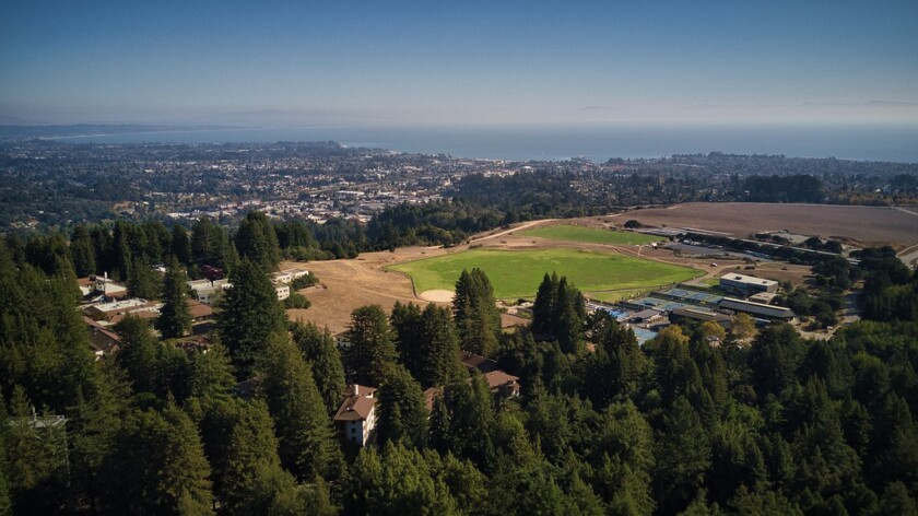 Aerial view looking out across the UCSC campus and Santa Cruz.