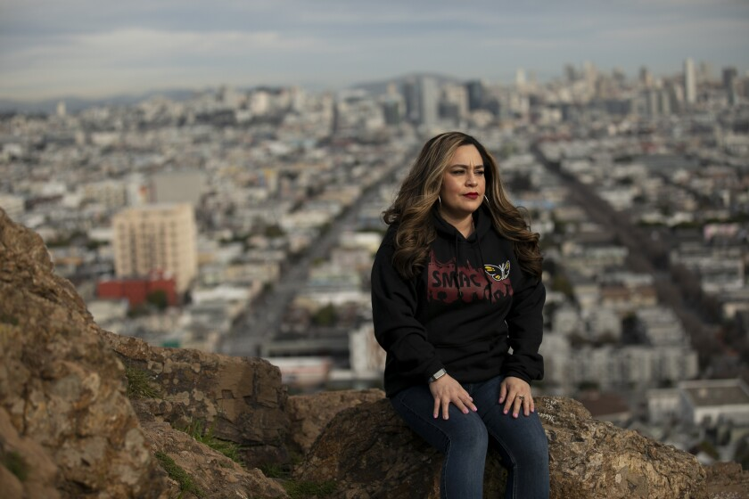 San Francisco native Veronica Garcia sits for a portrait at Bernal Heights park on Feb. 18, 2021.