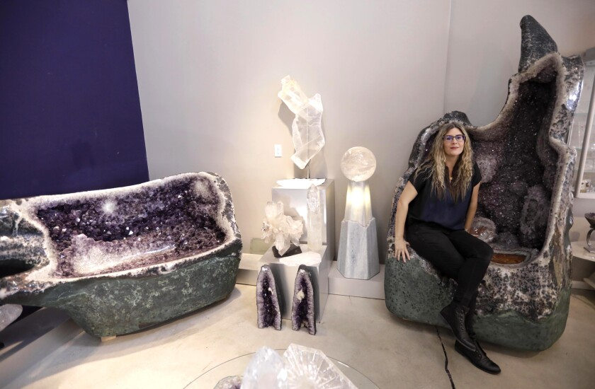 Cheryl Rey, curator and manager of Crystalarium, sits on a one-ton amethyst throne.