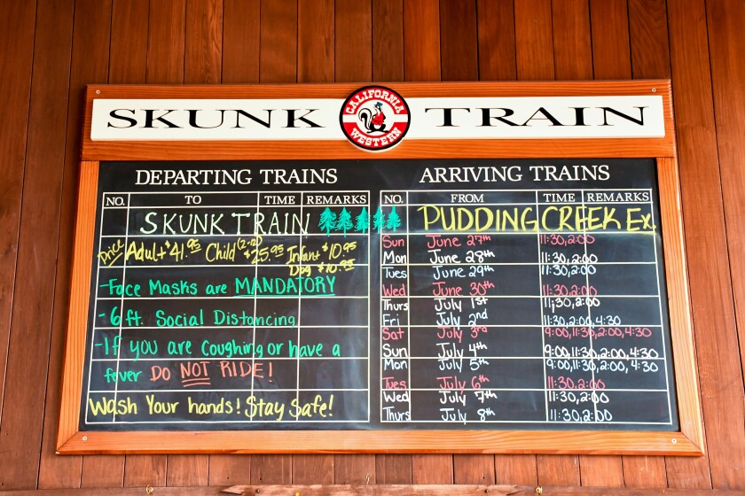 A board with the Skunk Train rules and schedule