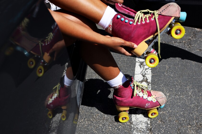 Dauterive puts on one of her hot pink skates on April 2, 2021.