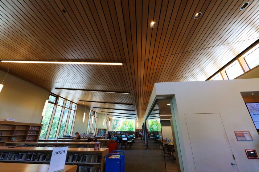 The high ceiling in the new library is meant to evoke the bottom of a ship's hull.