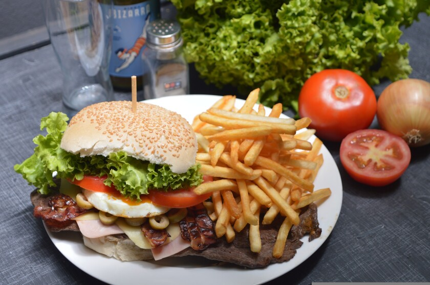 File image of burger and fries on plate