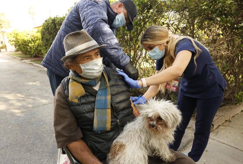 Senior citizen gets vaccinated