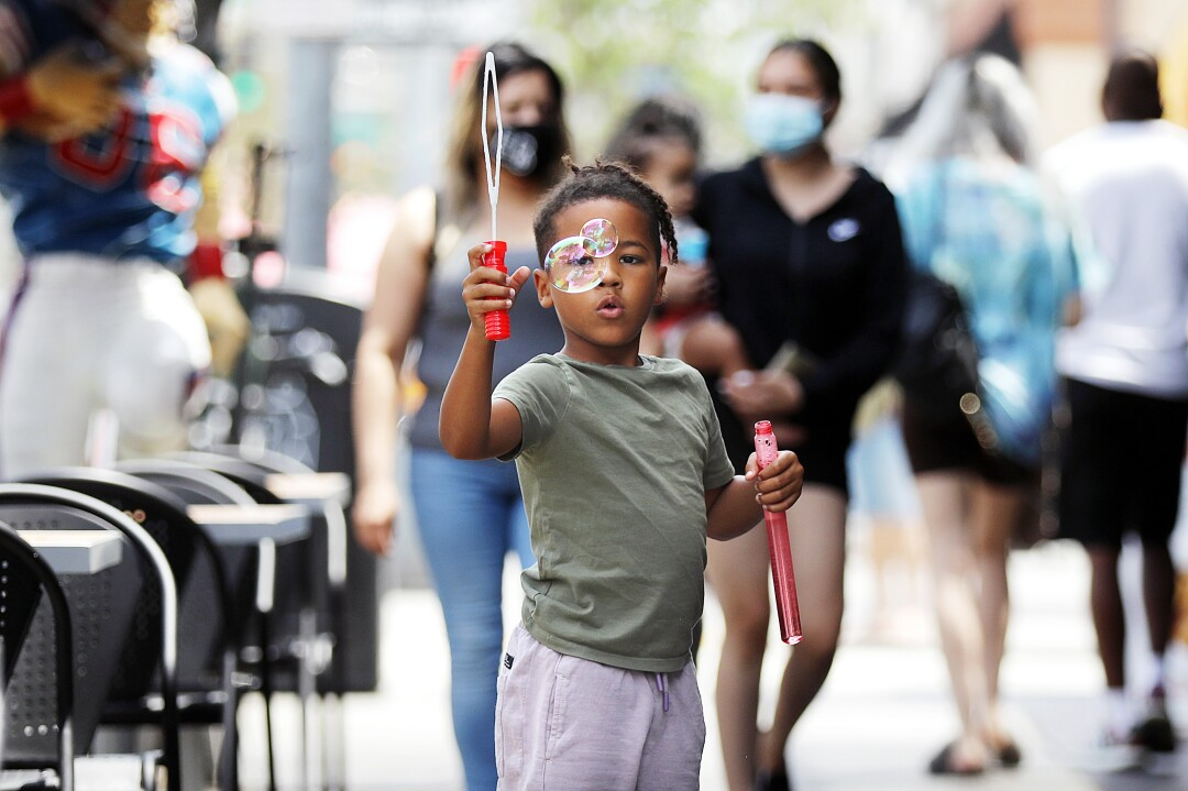 Tobias Blackmon, 6, plays with bubbles on Second Street in Belmont Shore on Tuesday, June 15, 2021.