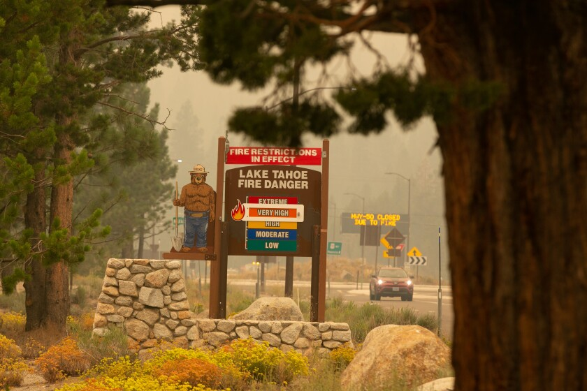 A sign in South Lake Tahoe warns of very high fire danger