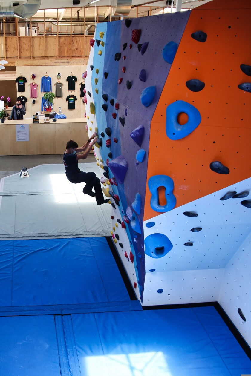 Daniel Hutton scales a wall at Agility Boulders in Capitola.