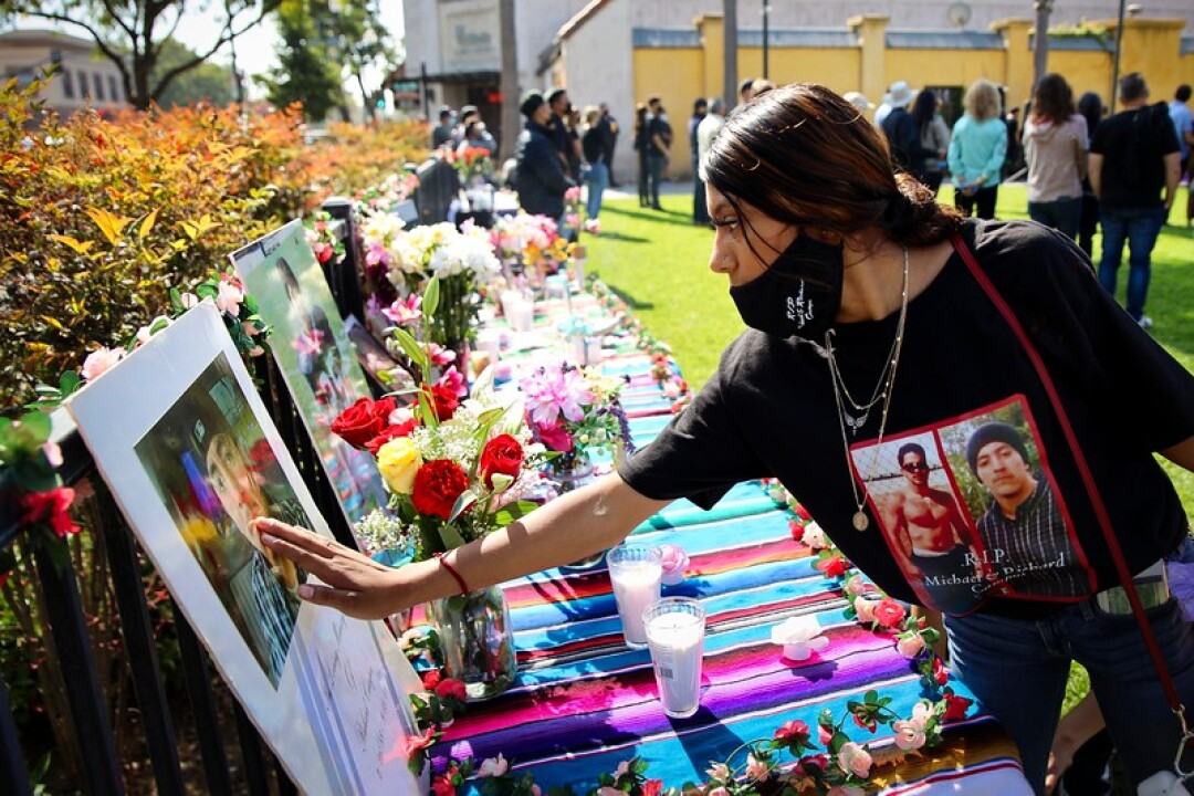 The mourning of many loved ones lost was part of the Romo Park vigil.