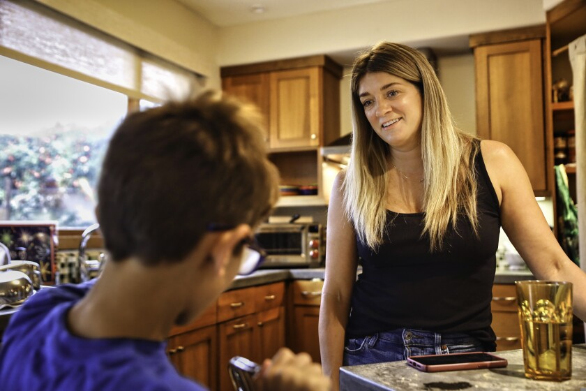 Jamie Sanyal talks to her son Cooper, 8, as he gets ready to go to school at Bay Front Elementary in Santa Cruz.