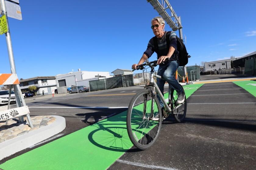 A Santa Cruz local enjoys his ride down the new trail rail path.