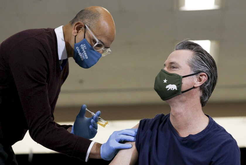 Gov. Gavin Newsom receives the Johnson & Johnson COVID-19 vaccine