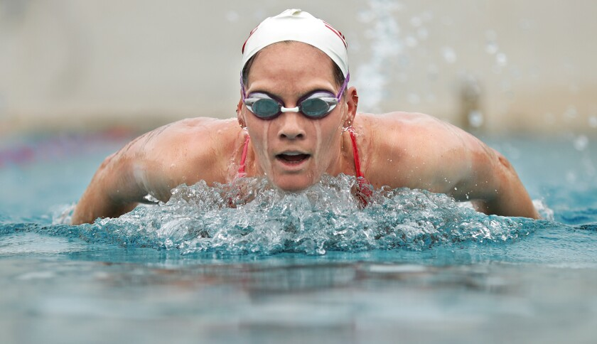 Alys Williams of the U.S. women's Olympic water polo team swims in goggles and cap.