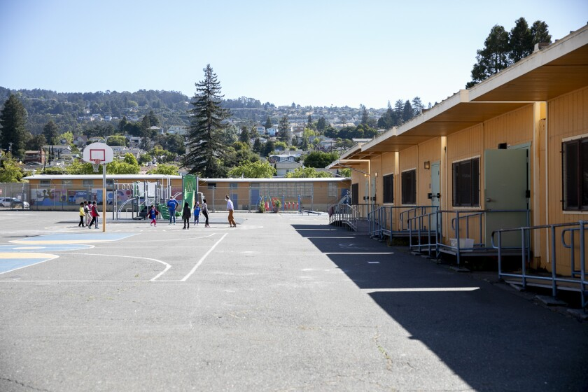 Students and teachers play on the playground