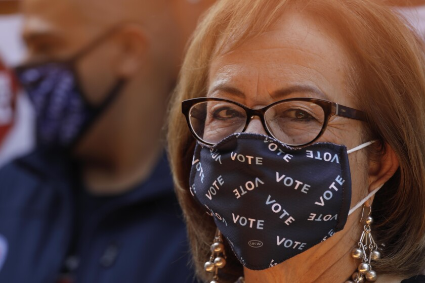 EAST LOS ANGELES, CA - AUGUST 14, 2021 - -California State Senator Maria Elena Durazo makes her statement with her mask and attended a presser with California Gov. Gavin Newsom and other Latino leaders in support of voting no on his recall at Hecho en Mexico restaurant in East Los Angeles on August 14, 2021. Governor Newsom met with volunteers who were working the phone banks calling voters to vote agains the recall at the restaurant. Los Angeles City Councilman Kevin de Leon, California Assemblyman Miguel Santiago and other dignitaries were on hand to support the governor. (Genaro Molina/Los Angeles Times)