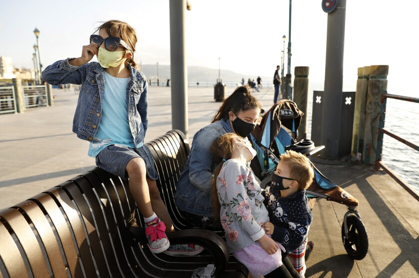 Juliet Brown, 5, left, visits the Redondo Beach Pier with her siblings Evelyn, 7, and Joshua, 2, center, and their nanny