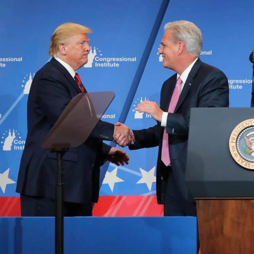 Former President Donald Trump shakes the hand of Rep. Kevin McCarthy, R-California.