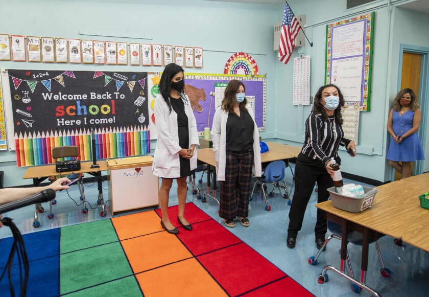 Administrators answer questions in a Los Angeles classroom