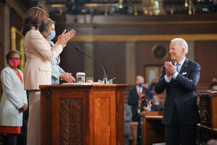 President Joe Biden applauds Vice President Kamala Harris and Speaker Nancy Pelosi