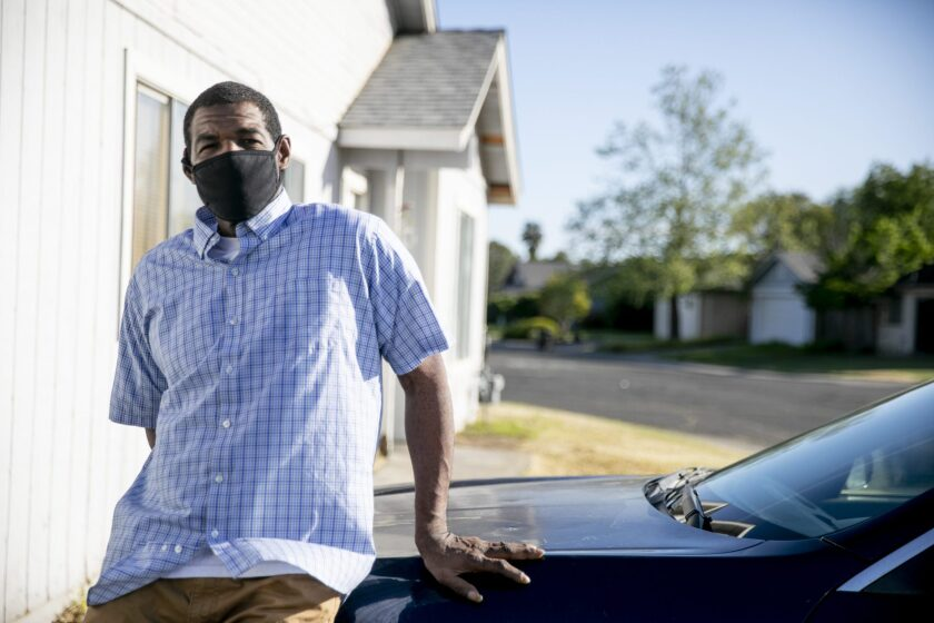Stacy Estes drives DoorDash to keep up with child support debt owed to the state. Photo by Anne Wernikoff, CalMatters