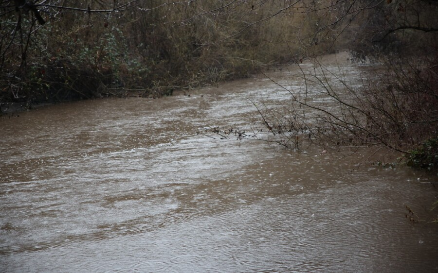 Signs on mountain roads Wednesday night continued to advise people to stay out of areas in debris-flow zones.