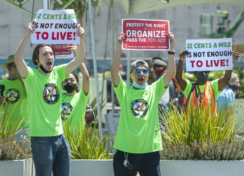 Rideshare drivers yell out to the drivers to turn off their apps and join the strike.