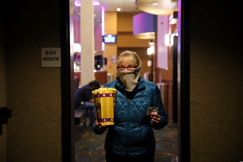 Linda Patterson says she was excited to return to the movies Thursday, including because of the popcorn.