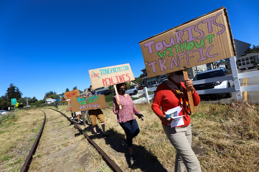 Protestors in Aptos Village on Wednesday.