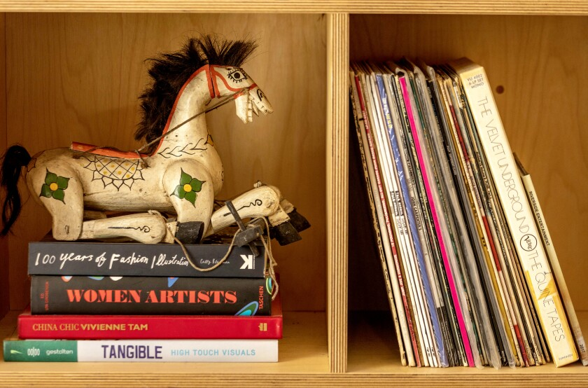 Records and books on a bookshelf.