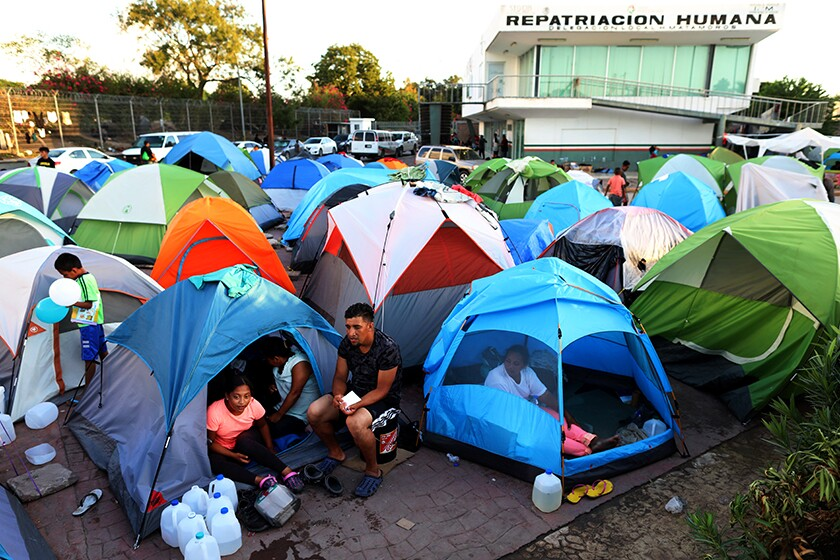 Migrants from Central America and Mexico await the outcome of their U.S. immigration court cases in a tent encampment