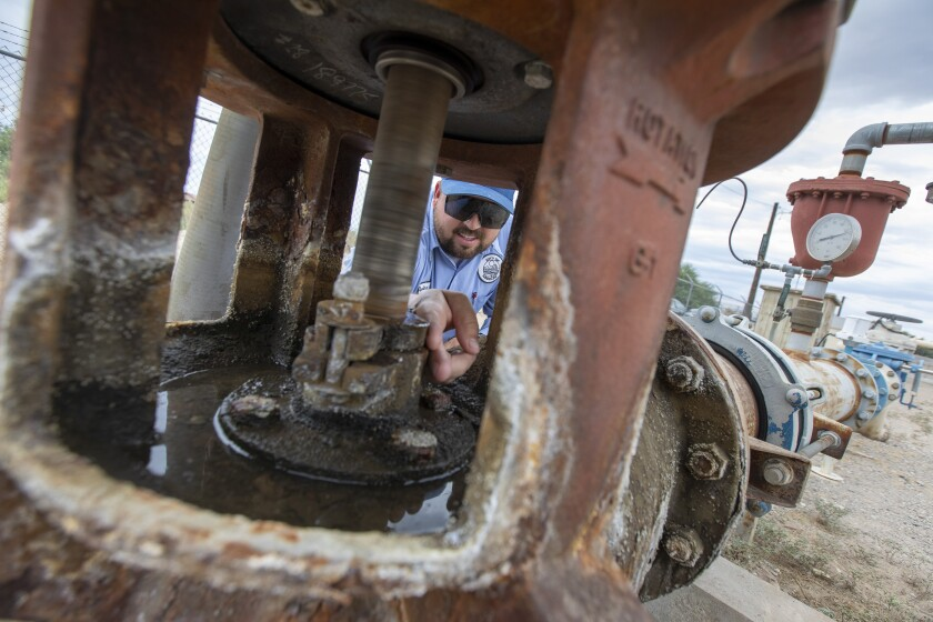 City of Needles Water operator Taylor Miller inspects the pump packing at well 15, the only operating water supply