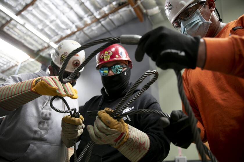 Apprentices sort through wire ropes called chokers at Iron Workers in Benicia on June 20, 2021.