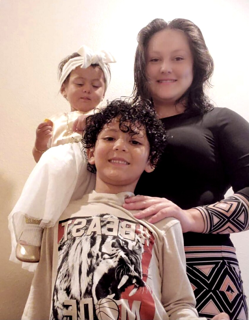 Sofia Lima with daughter Daniela, 2, left, and son Dennis, 7.