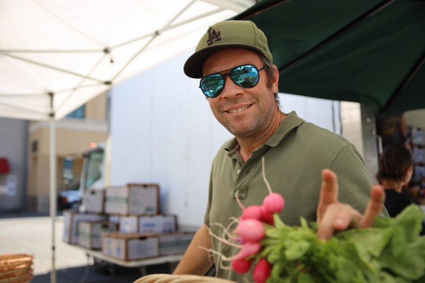 Ben Amago of Blue Heron Farms at the downtown farmers market