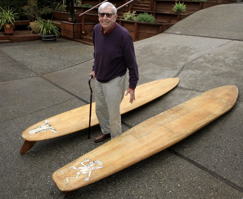 Don McPherson, with the balsa surfboards he shaped himself in the 1950s.