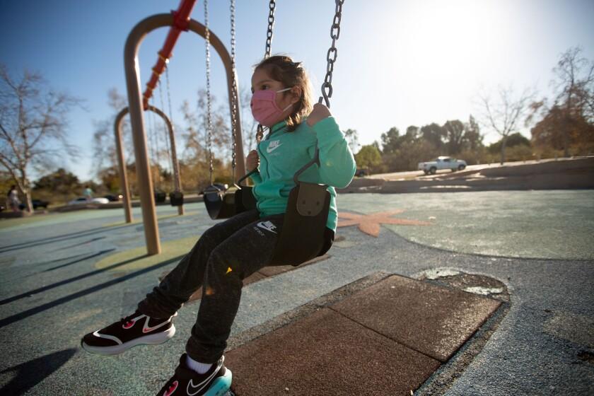 Mae Villanueva, 4, plays at Lake Balboa Park in Van Nuys on Jan. 20, 2021.